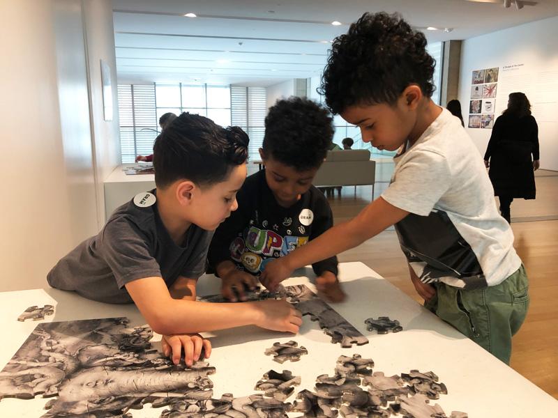 GRAM-Kids-doing-an-art-puzzle-at-the-Grand-Rapids-Art-Museum