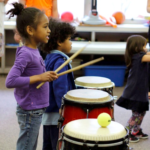 Artists Creating Together Drumming Girl