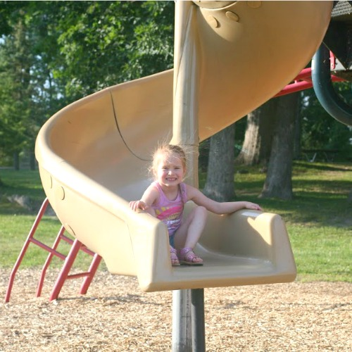 Myers Lake girl on slide