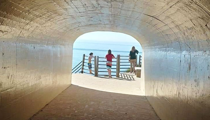 lake michigan beaches: tunnel park - family at end of tunnel