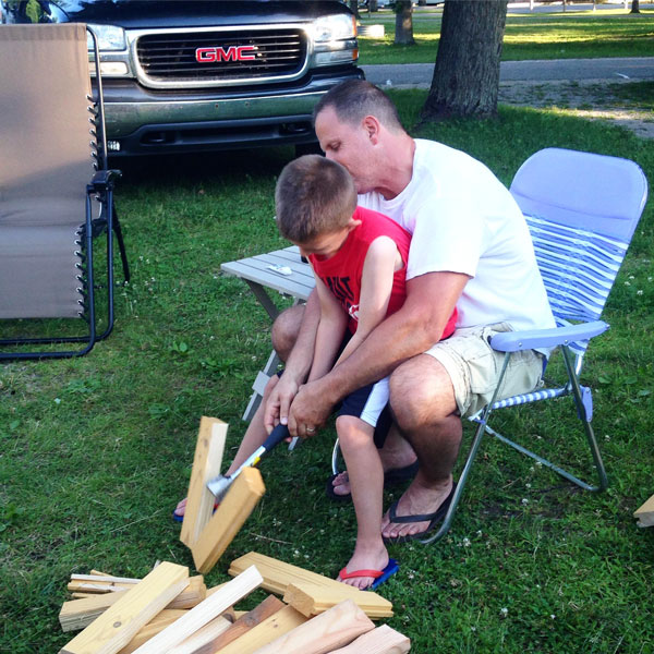 camping activities for kids: chopping firewood