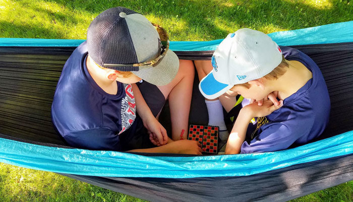 Camping Things to do hammock boys checkers feature image