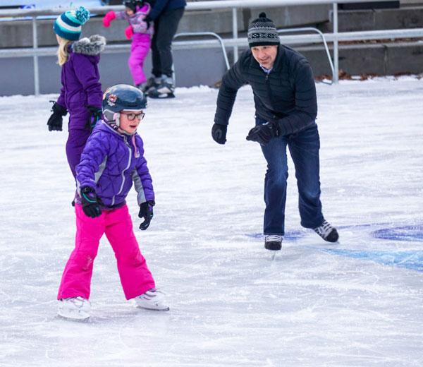 Rosa Parks Circle girl ice skating with dad