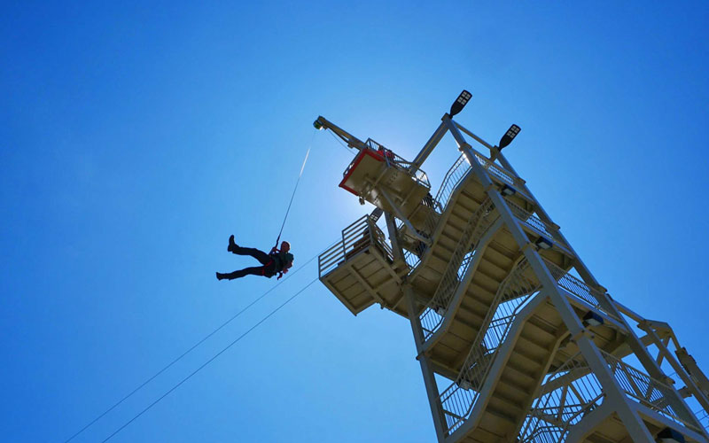 Person flying high at Allegan Event's outdoor course