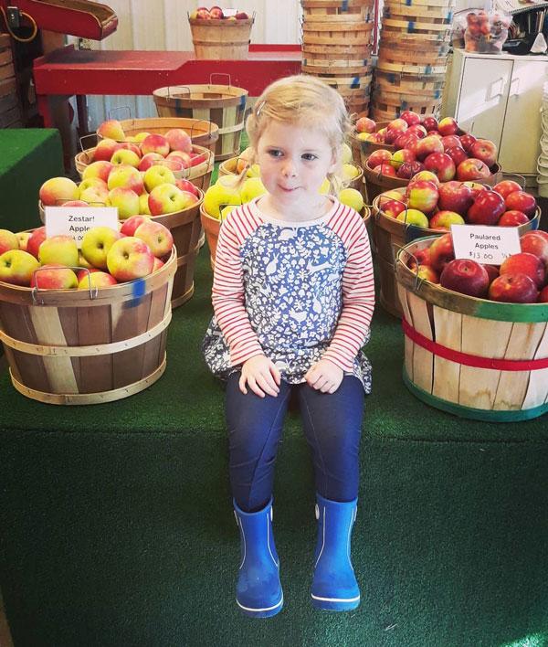Moelker Orchards Sneller apples girl fall