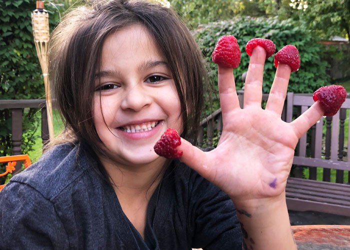 Gardening with Kids Girl with raspberry fingers Brooks