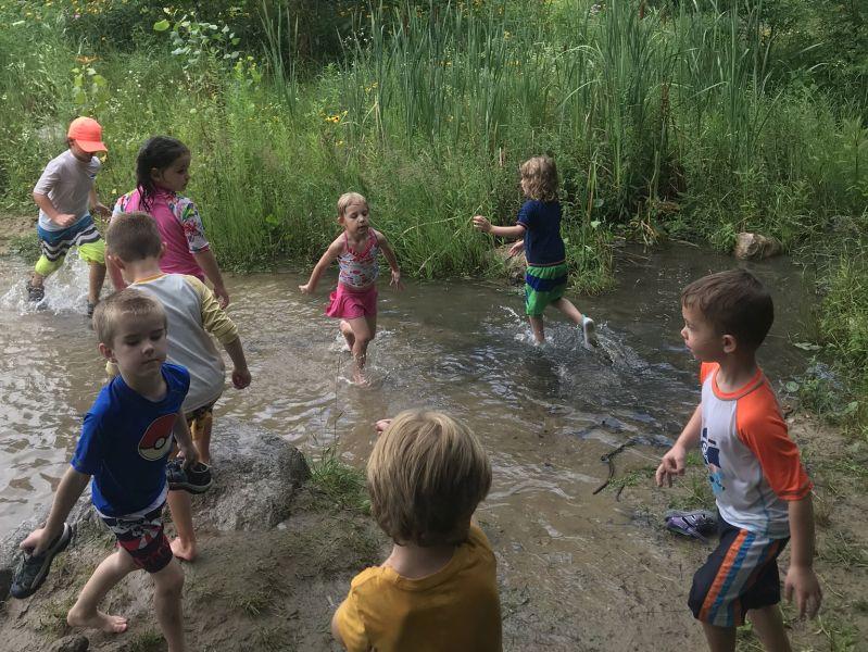 Kalamazoo Nature Center kids playing in creek