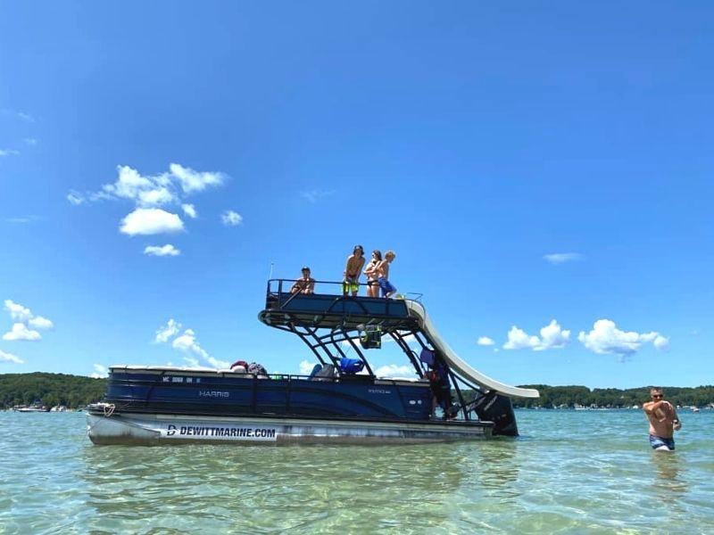 torch lake pontoon boat swimming 1