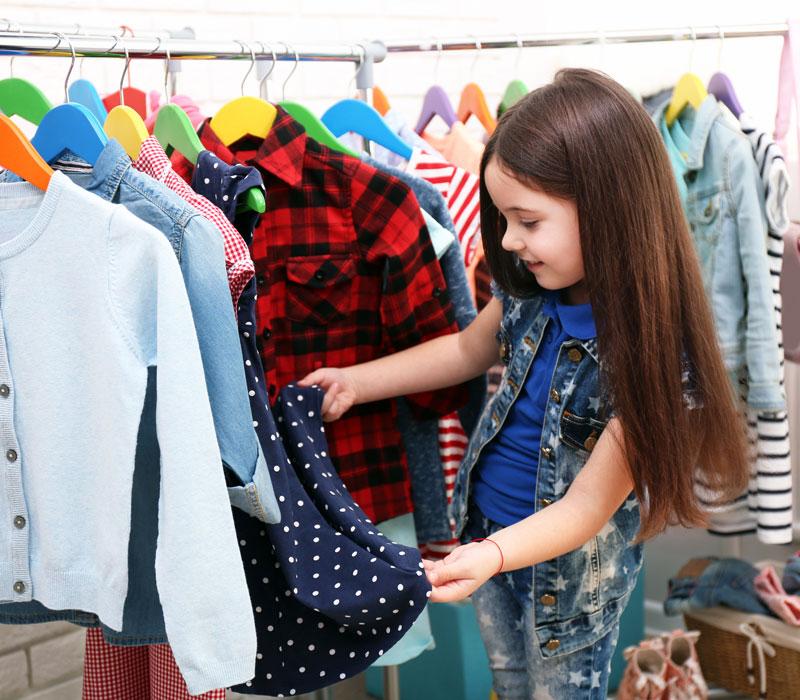 Grandtastic Shopping girl looking at clothes
