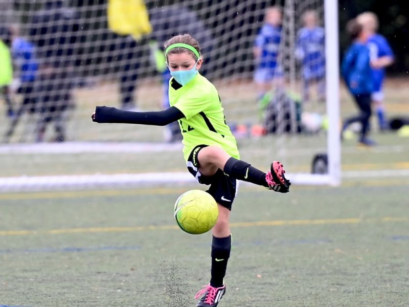 Michigan Sports Academies summer camp 2021 masked girl playing soccer