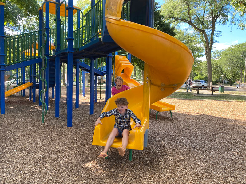 MLK park playground kids on slide happy Hunt